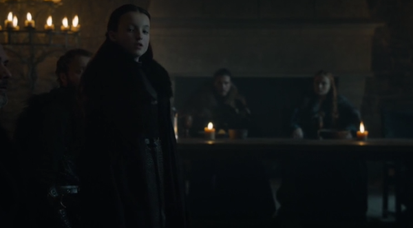 Lady Lyanna Mormont declares Jon Snow King of the North during a gathering inside the hall of Winterfell Castle.