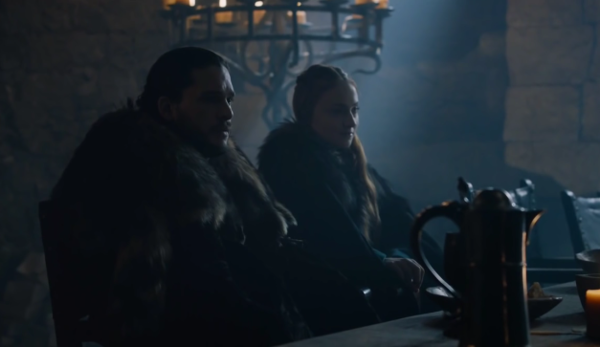 Rob and Sansa, seated at the main table inside the hall of Winterfell, listens in astonishment to Lady Lyanna Mormont.