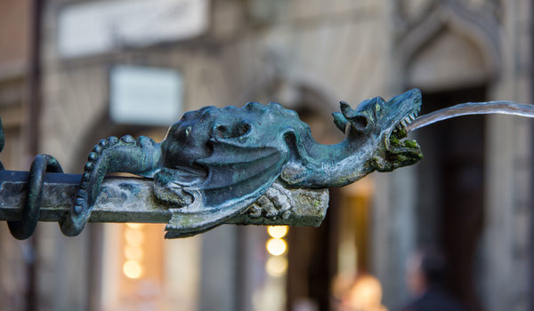 A dragon as a street drinking fountain in Lucerne