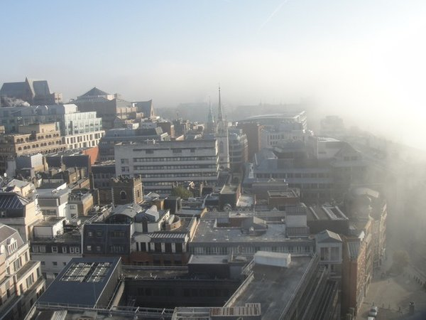 It is actually a 2010 photo, on a misty morning with the fog creeping over from the river, the Tower Bridge is still there under this white blanket in the right-hand upper corner.