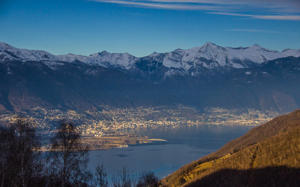 From here we see the Swiss part of Lake Maggiore, namely the cities of Ascona and Locarno. If you'd like to have even better views over the lake then you might like a hike to Monte Gambarogno (1734m) which is several kilometers to the north.