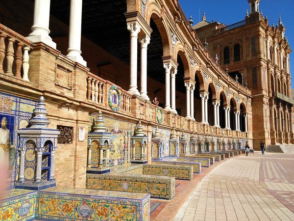 Mosiac and architecture inspires as far as the eye can see at the 'Plaza de Espana.' Seville, Spain.